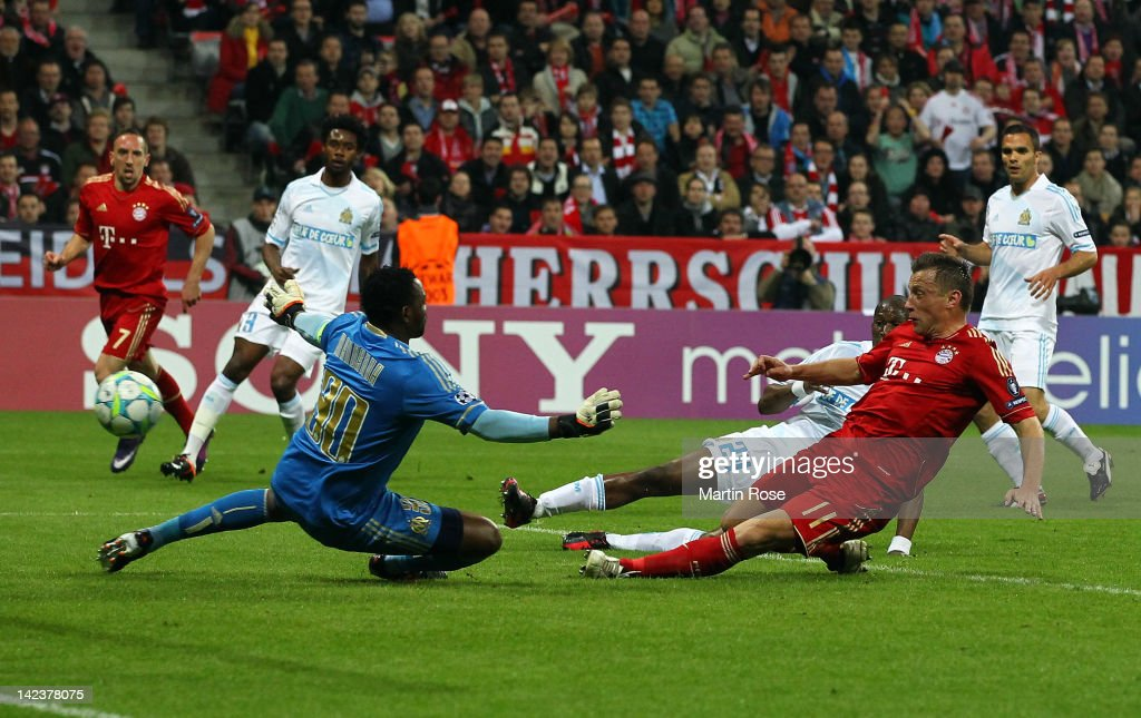 <a gi-track='captionPersonalityLinkClicked' href=/galleries/search?phrase=Ivica+Olic&family=editorial&specificpeople=547277 ng-click='$event.stopPropagation()'>Ivica Olic</a> (R) of Muenchen scores his team's opening goal during the UEFA Champions League quarter-final second leg match at Allianz Arena on April 3, 2012 in Munich, Germany.