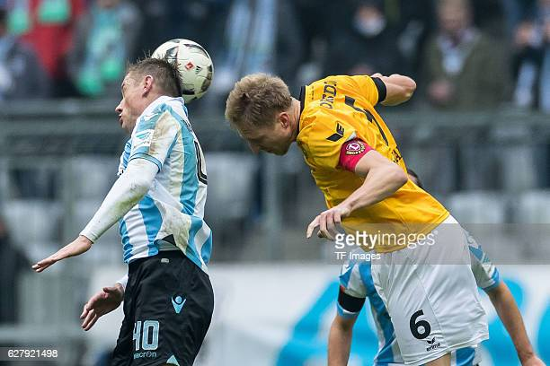 Ivica Olic of TSV 1860 Muenchen and Marco Hartmann of Dynamo Dresden battle for the ball during the Second Bandesliga match between TSV 1860 Muenchen...