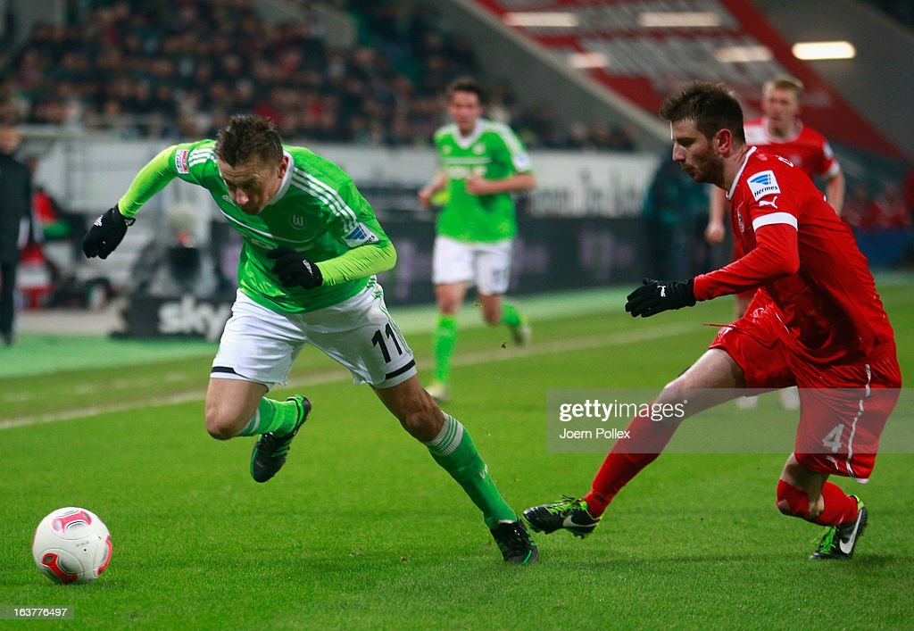 <a gi-track='captionPersonalityLinkClicked' href=/galleries/search?phrase=Ivica+Olic&family=editorial&specificpeople=547277 ng-click='$event.stopPropagation()'>Ivica Olic</a> (L) of Wolfsburg and Stylianos Malezas of Duesseldorf compete for the ball during the Bundesliga match between VfL Wolfsburg and Fortuna Duesseldorf 1895 at Volkswagen Arena on March 15, 2013 in Wolfsburg, Germany.