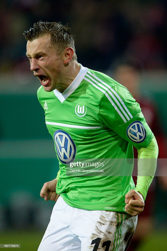 <a gi-track='captionPersonalityLinkClicked' href=/galleries/search?phrase=Ivica+Olic&family=editorial&specificpeople=547277 ng-click='$event.stopPropagation()'>Ivica Olic</a> of Wolfsburg celebrates after scoring his team's first goal during the DFB Cup match between Kickers Offenbach and VfL Wolfsburg on February 26, 2013 in Offenbach, Germany.