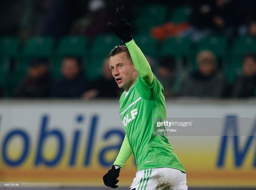 <a gi-track='captionPersonalityLinkClicked' href=/galleries/search?phrase=Ivica+Olic&family=editorial&specificpeople=547277 ng-click='$event.stopPropagation()'>Ivica Olic</a> of Wolfsburg celebrates after scoring his team's first goal during the Bundesliga match between VfL Wolfsburg and Fortuna Duesseldorf 1895 at Volkswagen Arena on March 15, 2013 in Wolfsburg, Germany.