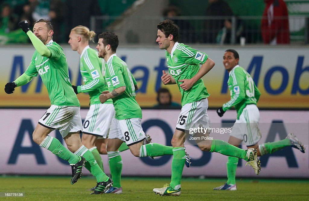 <a gi-track='captionPersonalityLinkClicked' href=/galleries/search?phrase=Ivica+Olic&family=editorial&specificpeople=547277 ng-click='$event.stopPropagation()'>Ivica Olic</a> (L) of Wolfsburg celebrates after scoring his team's first goal during the Bundesliga match between VfL Wolfsburg and Fortuna Duesseldorf 1895 at Volkswagen Arena on March 15, 2013 in Wolfsburg, Germany.