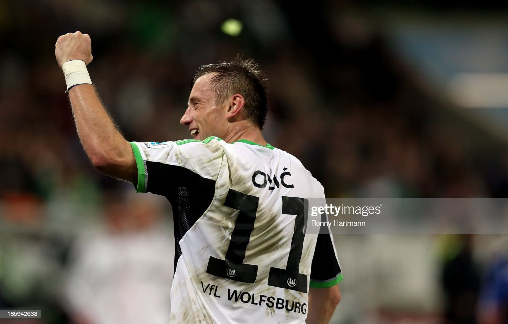 <a gi-track='captionPersonalityLinkClicked' href=/galleries/search?phrase=Ivica+Olic&family=editorial&specificpeople=547277 ng-click='$event.stopPropagation()'>Ivica Olic</a> of Wolfsburg celebrates his team's second goal during the Bundesliga match between VfL Wolfsburg and Werder Bremen at Volkswagen Arena on October 26, 2013 in Wolfsburg, Germany.
