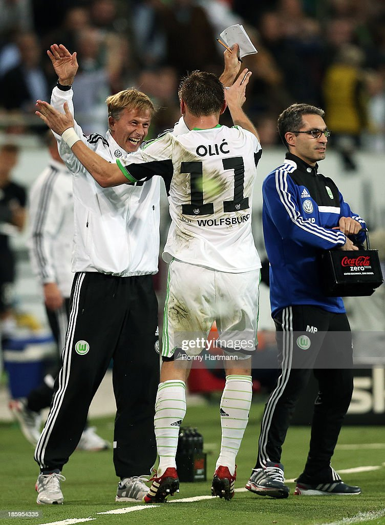 <a gi-track='captionPersonalityLinkClicked' href=/galleries/search?phrase=Ivica+Olic&family=editorial&specificpeople=547277 ng-click='$event.stopPropagation()'>Ivica Olic</a> (C) of Wolfsburg celebrates his team's second goal with assistant coach <a gi-track='captionPersonalityLinkClicked' href=/galleries/search?phrase=Andries+Jonker&family=editorial&specificpeople=5948822 ng-click='$event.stopPropagation()'>Andries Jonker</a> (L) and physiotherapist Michele Putaro of Wolfsburg during the Bundesliga match between VfL Wolfsburg and Werder Bremen at Volkswagen Arena on October 26, 2013 in Wolfsburg, Germany.