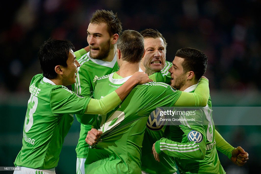 <a gi-track='captionPersonalityLinkClicked' href=/galleries/search?phrase=Ivica+Olic&family=editorial&specificpeople=547277 ng-click='$event.stopPropagation()'>Ivica Olic</a> of Wolfsburg celebrates with teammates after scoring his team's first goal during the DFB Cup match between Kickers Offenbach and VfL Wolfsburg on February 26, 2013 in Offenbach, Germany.