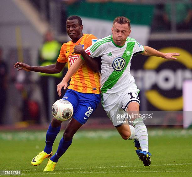 Ivica Olic of Wolfsburg challenges for the ball with Adrian Ramos of Berlin during the Bundesliga match between VfL Wolfsburg and Hertha BSC at...