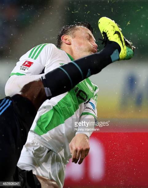 Ivica Olic of Wolfsburg is challenged by Johan Djourou of Hamburg during the Bundesliga match between VfL Wolfsburg and Hamburger SV at Volkswagen...