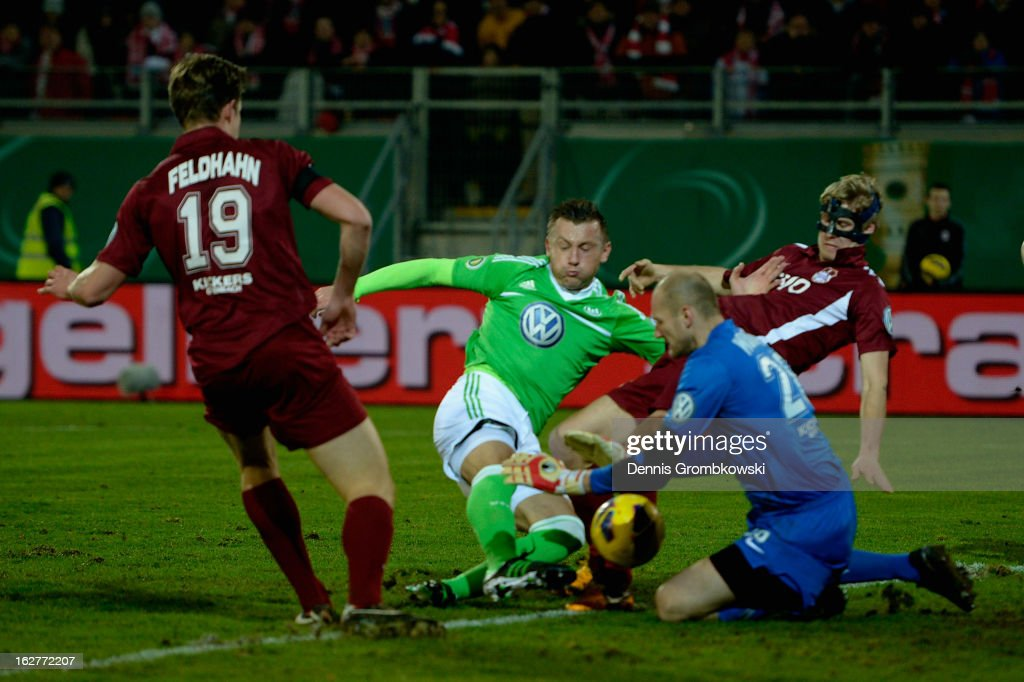 <a gi-track='captionPersonalityLinkClicked' href=/galleries/search?phrase=Ivica+Olic&family=editorial&specificpeople=547277 ng-click='$event.stopPropagation()'>Ivica Olic</a> of Wolfsburg misses a chance at goal against goalkeeper Robert Wulnikowski of Offenbach during the DFB Cup match between Kickers Offenbach and VfL Wolfsburg on February 26, 2013 in Offenbach, Germany.