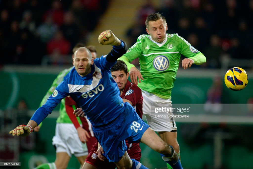 <a gi-track='captionPersonalityLinkClicked' href=/galleries/search?phrase=Ivica+Olic&family=editorial&specificpeople=547277 ng-click='$event.stopPropagation()'>Ivica Olic</a> of Wolfsburg scores his team's first goal during the DFB Cup match between Kickers Offenbach and VfL Wolfsburg on February 26, 2013 in Offenbach, Germany.