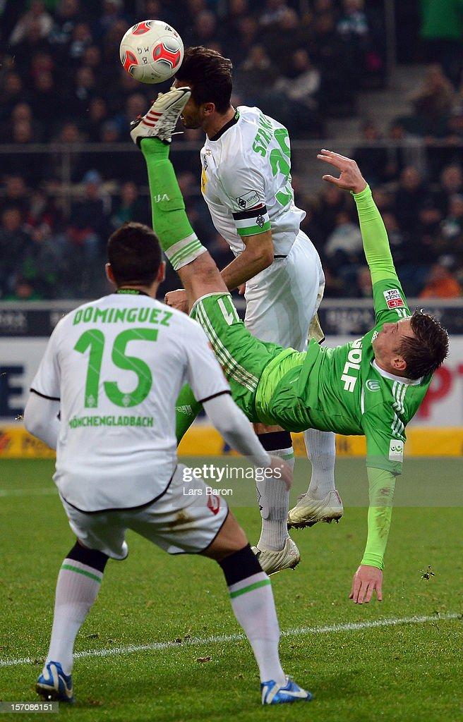 Ivica Olic of Wolfsburg tries an overheadkick next to Martin Stranzl of Moenchengladbach during the Bundesliga match between Borussia...