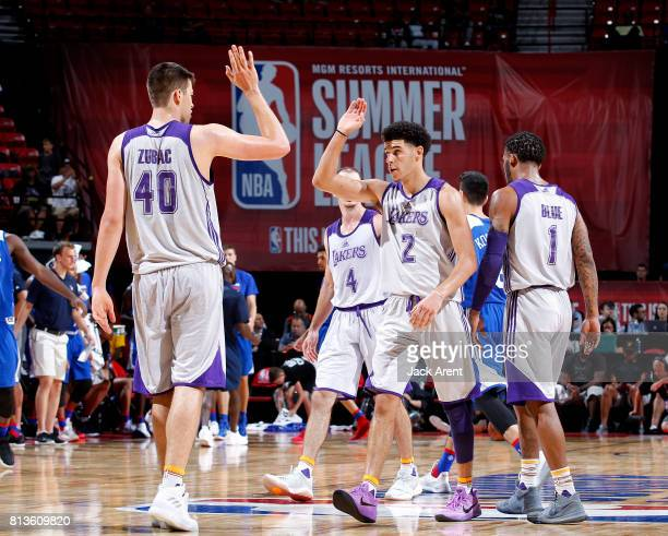 Ivica Zubac and Lonzo Ball of the Los Angeles Lakers high five each other during the game against the Philadelphia 76ers during the 2017 Las Vegas...