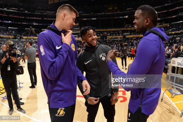 Ivica Zubac of the Los Angeles Lakers D'Angelo Russell of the Brooklyn Nets and Luol Deng of the Los Angeles Lakers are seen prior to the game...