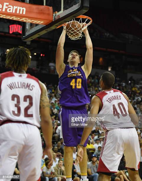 Ivica Zubac of the Los Angeles Lakers dunks in front of TJ Williams and Edy Tavares of the Cleveland Cavaliers during the 2017 Summer League at the...