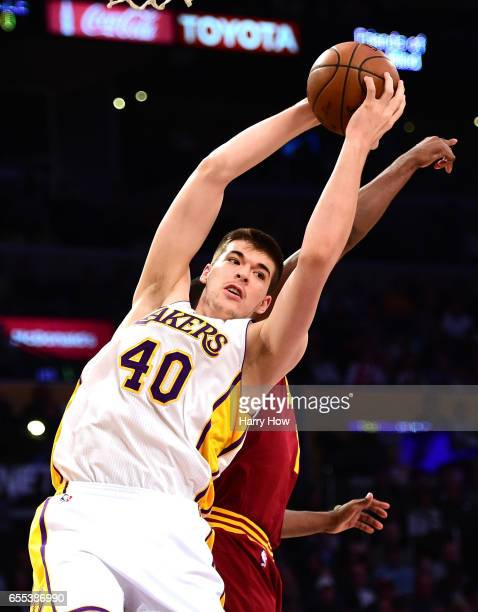 Ivica Zubac of the Los Angeles Lakers grabs a rebound during the first half against the Cleveland Cavaliers at Staples Center on March 19 2017 in Los...