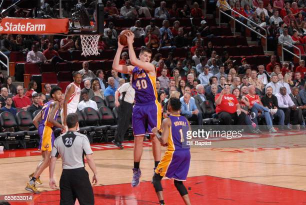 Ivica Zubac of the Los Angeles Lakers grabs the rebound during a game against the Houston Rockets on March 15 2017 at the Toyota Center in Houston...