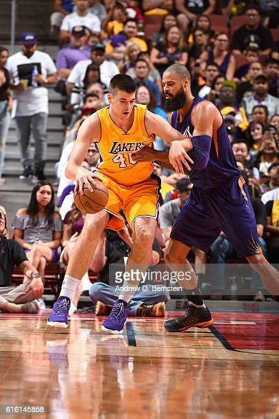 Ivica Zubac of the Los Angeles Lakers handles the ball against Tyson Chandler of the Phoenix Suns during a preseason game on October 21 2016 at Honda...