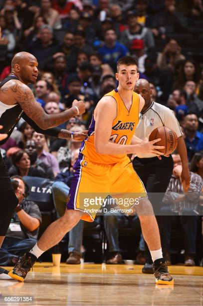 Ivica Zubac of the Los Angeles Lakers handles the ball during a game against the LA Clippers on March 21 2017 at STAPLES Center in Los Angeles...