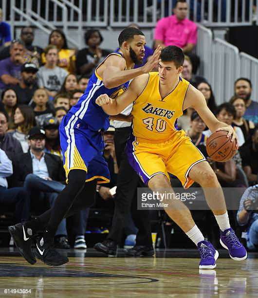 Ivica Zubac of the Los Angeles Lakers is guarded by JaVale McGee of the Golden State Warriors during their preseason game at TMobile Arena on October...