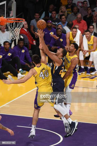 Ivica Zubac of the Los Angeles Lakers Rudy Gobert of the Utah Jazz and Josh Hart of the Los Angeles Lakers vie for the ball during the preseason game...