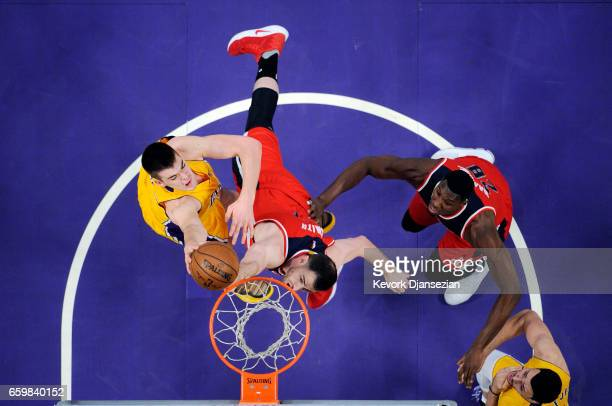 Ivica Zubac of the Los Angeles Lakers scores over Jason Smith of the Washington Wizards with Ian Mahinmi of the Washington Wizards and Larry Nance Jr...