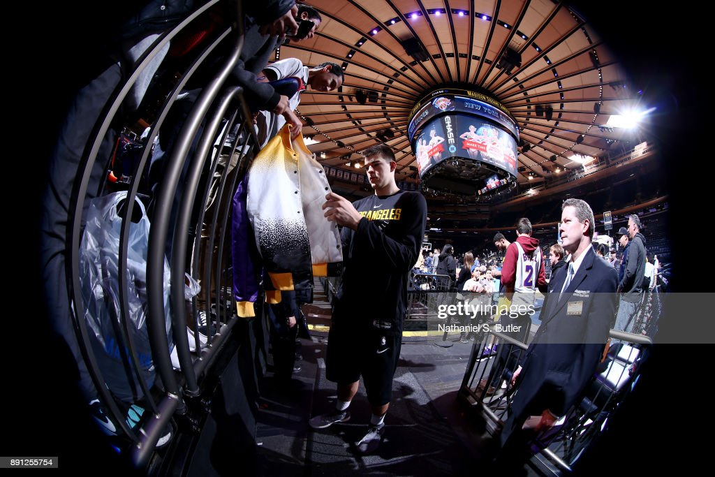 Ivica Zubac #40 of the Los Angeles Lakers signs an autograph for a fan prior to the game against the New York Knicks on December 12, 2017 at Madison Square Garden in New York, New York.