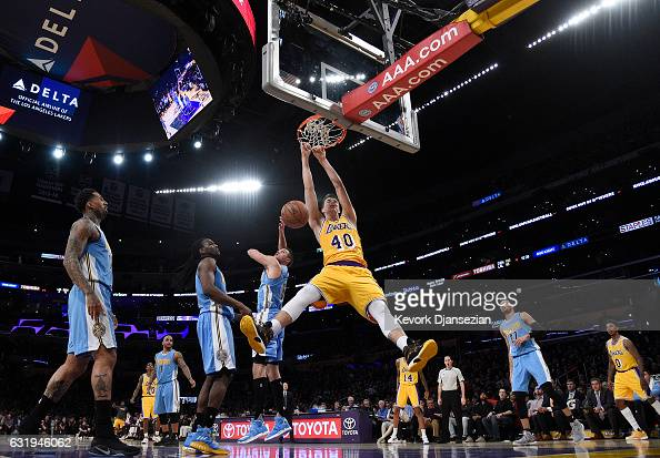 Ivica Zubac of the Los Angeles Lakers slam dunks against Danilo Gallinari and Kenneth Faried of the Denver Nuggets during the second half at Staples...