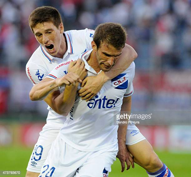 Iván Alonso of Nacional celebrates with Santiago Romero after scoring the first goal of his team during a match between Peñarol and Nacional as part...