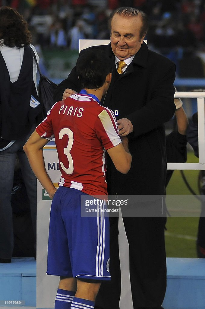 Iván Piris of Paraguay receives his medal prior the match between Uruguay and Paraguay during the Copa America 2011 at Antonio Vespucio Liberti Stadium on July 24, 2011 in Buenos Aires, Argentina.