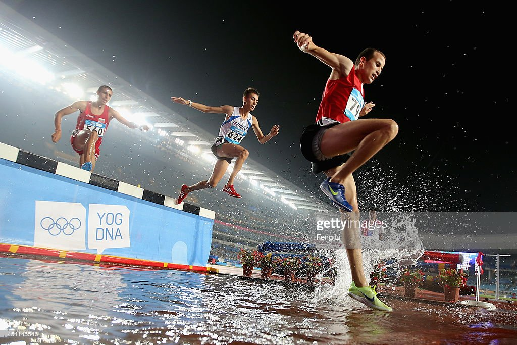 Ivo Balabanov of Bulgaria, Anthony Pontier of France and Soufien Cherni of Tunisia compete in Men's 2000m Steeplechase Final during day nine of Nanjing 2014 Summer Youth Olympic Games at the Nanjing Olympic Sports Centre on August 25, 2014 in Nanjing, China.