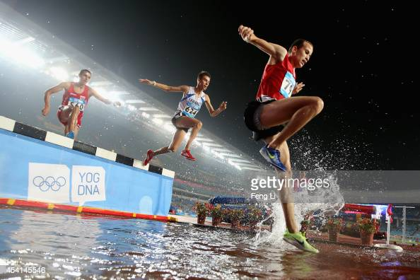 Ivo Balabanov of Bulgaria Anthony Pontier of France and Soufien Cherni of Tunisia compete in Men's 2000m Steeplechase Final during day nine of...