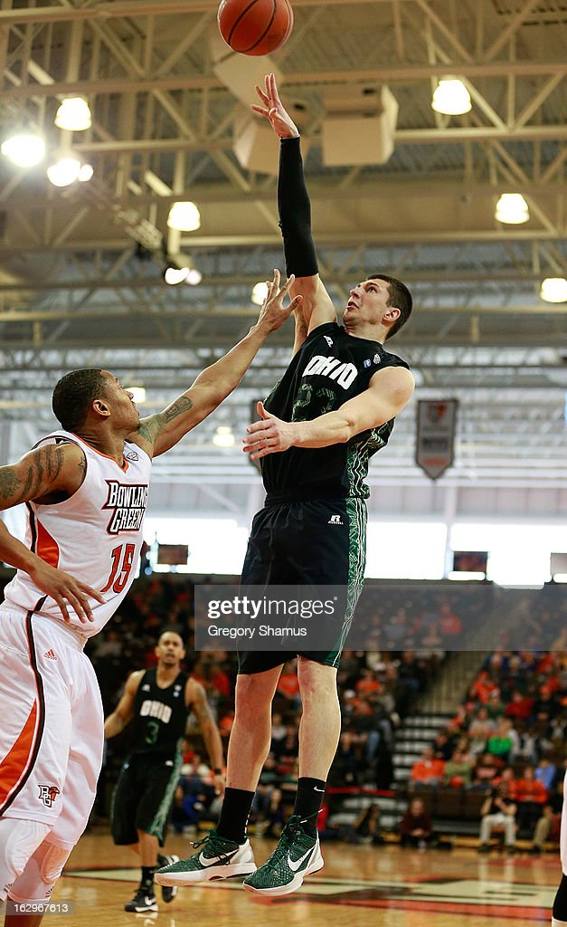 Ivo Baltic #23 of the Ohio Bobcats takes a second-half shot over A'uston Calhoun #15 of the Bowling Green Falcons at the Stroh Center on March 2, 2013 in Bowling Green, Ohio. Ohio won the game 78-65.