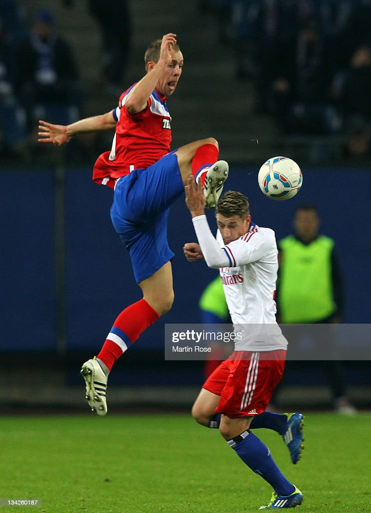 Ivo Ilicevic (R) of Hamburg and Steven Whittaker (L) of Glasgow battle for the ball during the friendly match between Hamburger SV and Glasgow Rangers at Imtech Arena on November 29, 2011 in Hamburg, Germany. (Photo by Martin Rose/Bongarts/Getty Images).