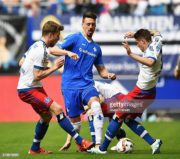 Ivo Ilicevic of Hamburg is challenged by Sandro Wagner of Darmstadt during the Bundesliga match between Hamburger SV and SV Darmstadt 98 at...