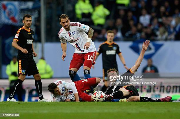 Ivo Ilicevic of Hamburger SV and Dominic Peitz of Karlsruher SC battle for the ball during the Bundesliga Playoff first leg match between Hamburger...