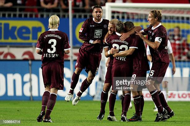 Ivo Ilicevic of Kaiserslautern celebrates his team's first goal with team mates during the Bundesliga match between 1 FC Kaiserslautern and FC Bayern...
