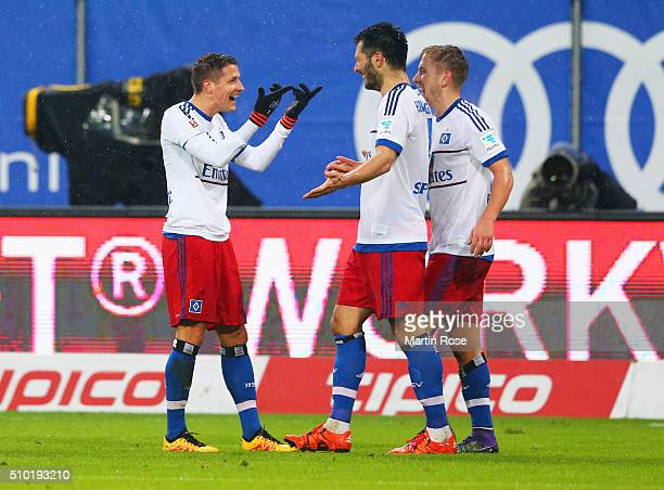 Ivo Ilicevic of SV Hamburg celebrates with Emir Spahic and Lewis Holtby as he scores their third goal during the Bundesliga match between Hamburger...