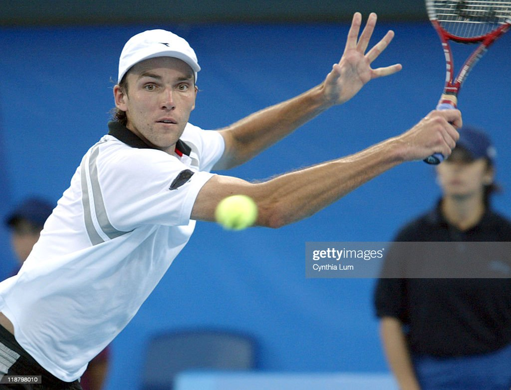 <a gi-track='captionPersonalityLinkClicked' href=/galleries/search?phrase=Ivo+Karlovic&family=editorial&specificpeople=605320 ng-click='$event.stopPropagation()'>Ivo Karlovic</a> (CRO) in action against <a gi-track='captionPersonalityLinkClicked' href=/galleries/search?phrase=Carlos+Moya&family=editorial&specificpeople=171236 ng-click='$event.stopPropagation()'>Carlos Moya</a> in the third round of men's singles during the Athens 2004 Olympics Games at Goudi Olympic Hall in Athens, Greece on August 17, 2004. <a gi-track='captionPersonalityLinkClicked' href=/galleries/search?phrase=Carlos+Moya&family=editorial&specificpeople=171236 ng-click='$event.stopPropagation()'>Carlos Moya</a> (ESP) wins the match with a score of (4,6), (7,6),