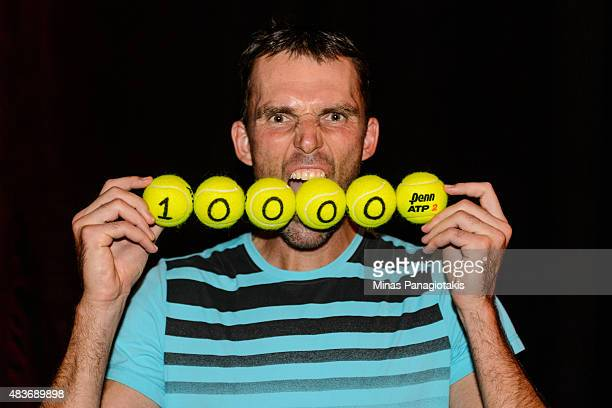 Ivo Karlovic of Croatia becomes the second player in history to reach 10000 aces during day two of the Rogers Cup at Uniprix Stadium against Milos...