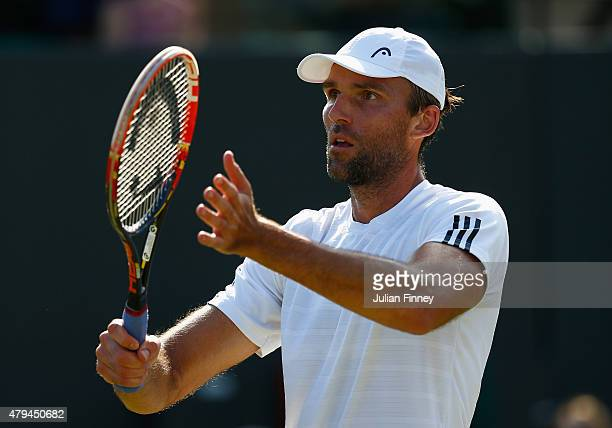 Ivo Karlovic of Croatia celebrates after winning his Mens Singles Third Round match against JoWilfried Tsonga of France during day six of the...