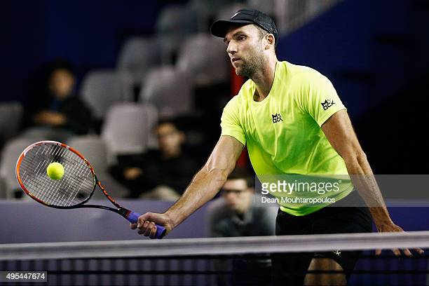 Ivo Karlovic of Croatia in action against Edouard RogerVasselin of France during Day 2 of the BNP Paribas Masters held at AccorHotels Arena on...