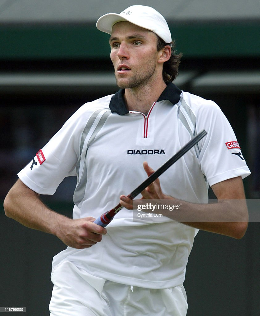 <a gi-track='captionPersonalityLinkClicked' href=/galleries/search?phrase=Ivo+Karlovic&family=editorial&specificpeople=605320 ng-click='$event.stopPropagation()'>Ivo Karlovic</a> of Croatia lost to <a gi-track='captionPersonalityLinkClicked' href=/galleries/search?phrase=Roger+Federer&family=editorial&specificpeople=157480 ng-click='$event.stopPropagation()'>Roger Federer</a> of Switzerland 3-6, 6-7, 6-7 in the fourth round of the Wimbledon Championships in London, Great Britain on June 28, 2004.