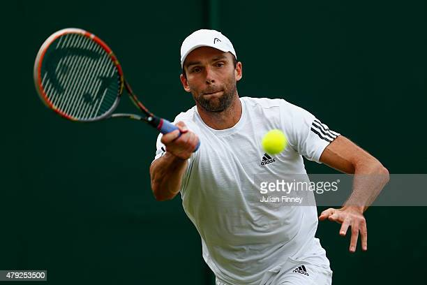 Ivo Karlovic of Croatia plays a forehand in his Gentlemens Singles Second Round match against Alexandr Dolgopolov of Ukraine during day four of the...