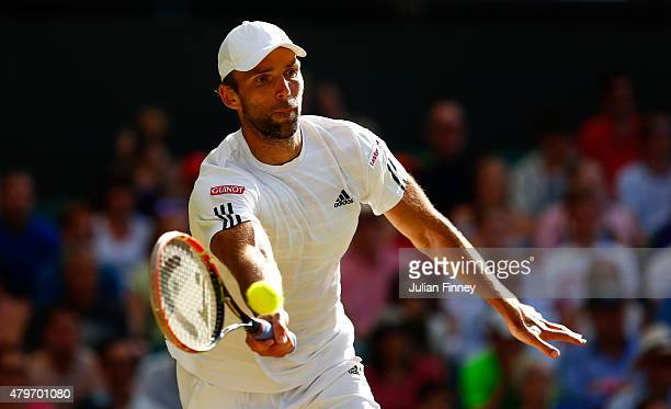 Ivo Karlovic of Croatia plays a forehand in his Gentlemen's Singles Fourth Round match against Andy Murray of Great Britain during day seven of the...