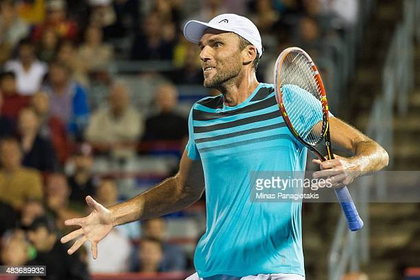 Ivo Karlovic of Croatia reacts after defeating Milos Raonic of Canada during day two of the Rogers Cup at Uniprix Stadium on August 11 2015 in...