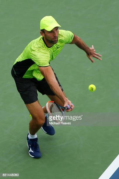Ivo Karlovic of Croatia returns a shot against Jiri Vesely of the Czech Republic during Day 3 of the Western and Southern Open at the Lindner Family...