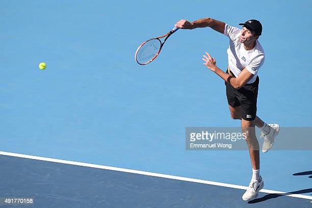 Ivo Karlovic of Croatia serves against Pablo Cuevas of Uruguay during the day six of the 2015 China Open at the China National Tennis Center on...