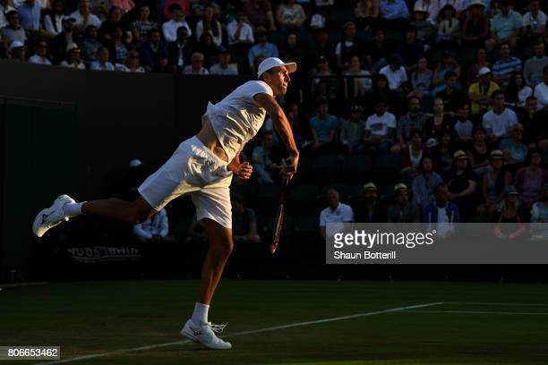 Ivo Karlovic of Croatia serves during the Gentlemen's Singles first round match against Aljaz Bedene of Great Britain on day one of the Wimbledon...