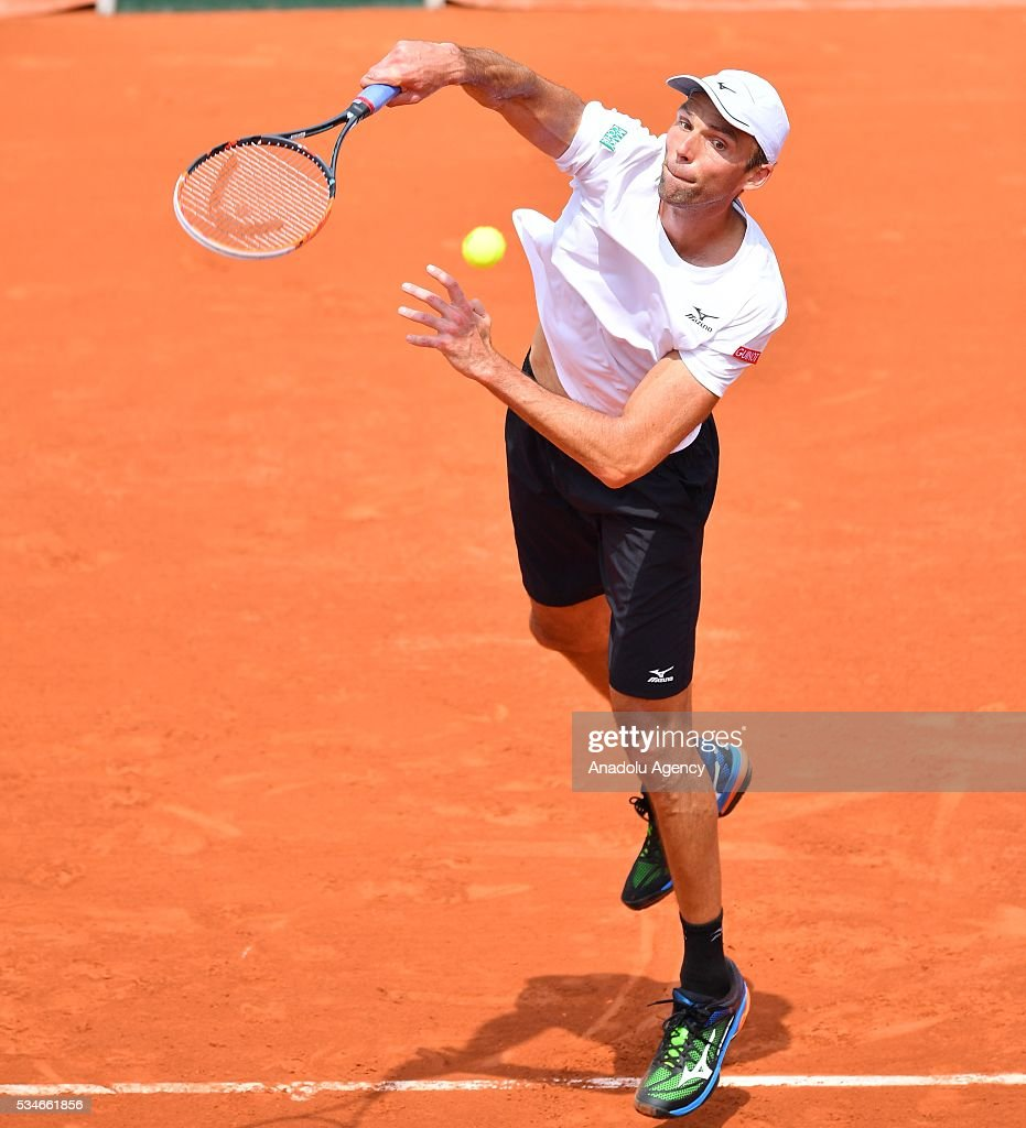 Ivo Karlovic of Croatia serves to Andy Murray of United Kingdom (not seen) during the men's single third round match at the French Open tennis tournament at Roland Garros Stadium in Paris, France on May 27, 2016.