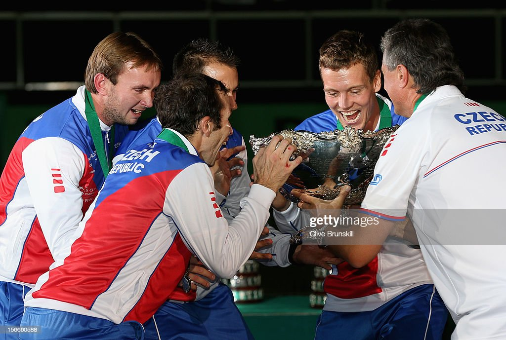 Ivo Minar,Lukas Rosol,Radek Stepanek,Tomas Berdych and team captain Jaroslav Navratil of Czech Republic about to lift the winners trophy aloft after a 3-2 victory against Spain during day three of the final Davis Cup match between Czech Republic and Spain at the 02 Arena on November 18, 2012 in Prague, Czech Republic.