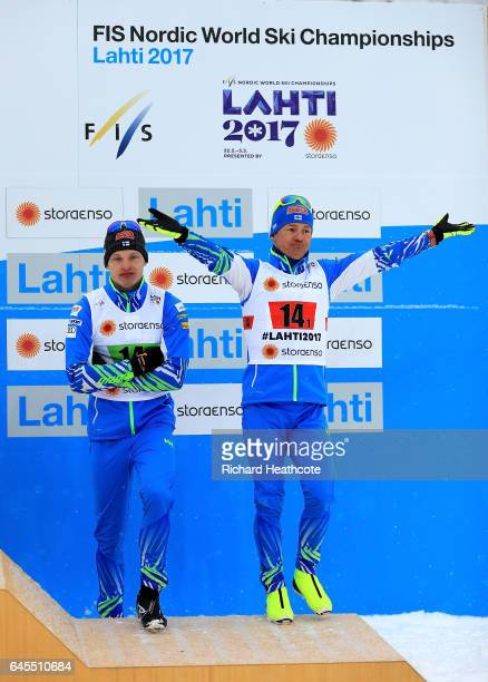Ivo Niskanen of Finland celebrate with team mate Sami Jauhojaervi the 3rd place in the Men's and Women's Cross Country Team Sprint Final during the...